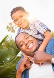Mixed Race Son and African American Father Playing Piggyback Out Stock Photography