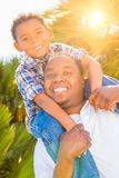 Mixed Race Son and African American Father Playing Piggyback Royalty Free Stock Image