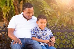 Mixed Race Son and African American Father Talking Outdoors royalty free stock image