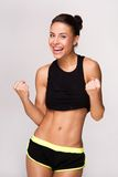 Mixed race sporty woman gains victory Stock Image