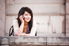 Mixed race student on the phone Royalty Free Stock Photo