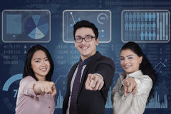 Mixed race teamwork with futuristic interface Stock Image