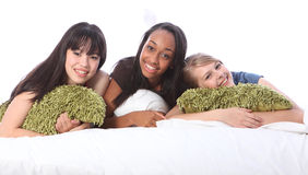 Mixed race teenage girl friends at slumber party royalty free stock image