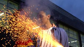 Mixed-race teenagers hugging outdoor in bright sparks, pastime, slow-motion. Stock footage stock video