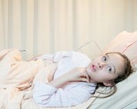 Mixed race tween girl in hospital bed Stock Photo