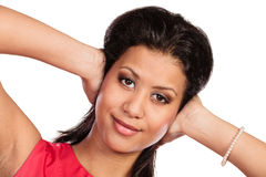 Mixed race woman closing ears with hands. Stock Photography