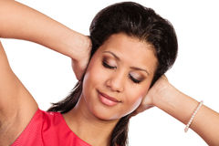 Mixed race woman closing ears with hands. stock images