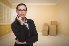 Mixed Race Woman in Empty Room with Boxes Royalty Free Stock Photography