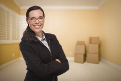 Mixed Race Woman in Empty Room with Boxes Stock Images