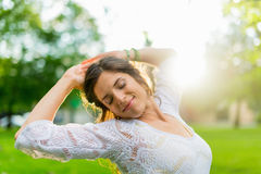 Mixed race woman feeling freedom at sunset Royalty Free Stock Image
