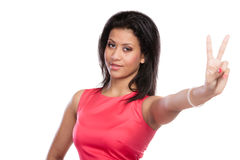 Mixed race woman girl giving peace v sign gesture. Royalty Free Stock Photo