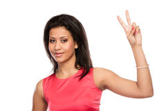 Mixed race woman girl giving peace v sign gesture. Royalty Free Stock Image