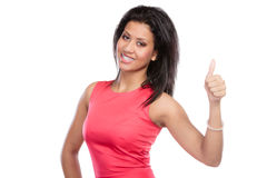 Mixed race woman giving thumb up gesture. Stock Photos