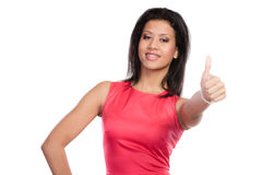 Mixed race woman giving thumb up gesture. Royalty Free Stock Image