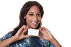 Mixed race woman holding a blank business card. Pretty spokes model with a blank business card Stock Photography