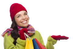 Mixed Race Woman Holding Shopping Bags Gesturing to Side Royalty Free Stock Images