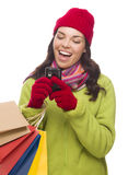 Mixed Race Woman Holding Shopping Bags Texting On Cell Phone Royalty Free Stock Image