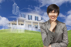 Mixed Race Woman Looks to Ghosted House Drawing Behind Stock Image
