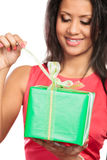 Mixed race woman opening box gift. Christmas. Stock Image
