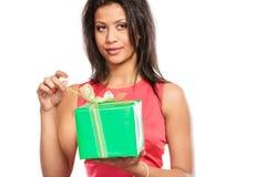 Mixed race woman opening box gift. Christmas. Stock Photography