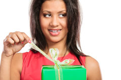 Mixed race woman opening box gift. Christmas. Royalty Free Stock Photos