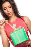 Mixed race woman opening box gift. Christmas. Royalty Free Stock Photography