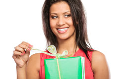 Mixed race woman opening box gift. Christmas. Royalty Free Stock Image