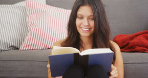 Mixed race woman reading a good book Royalty Free Stock Photos