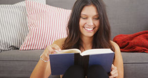 Mixed race woman reading a good book Stock Images
