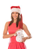 Mixed race woman in santa hat with little snowman. Royalty Free Stock Image