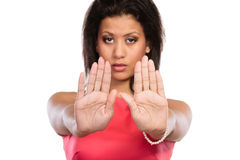 Mixed race woman showing stop sign gesture. Royalty Free Stock Photography
