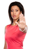 Mixed race woman showing stop sign gesture. Royalty Free Stock Photo