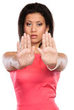 Mixed race woman showing stop sign gesture. Royalty Free Stock Photos