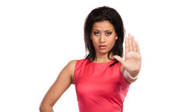 Mixed race woman showing stop sign gesture. Royalty Free Stock Image