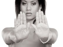 Mixed race woman showing stop sign gesture. Stock Photography