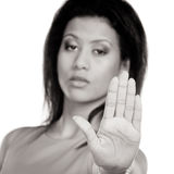Mixed race woman showing stop sign gesture. Royalty Free Stock Images