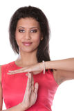 Mixed race woman showing time out gesture sign. Stock Image