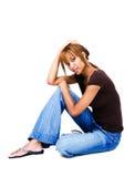 Mixed race woman sitting on floor Stock Image