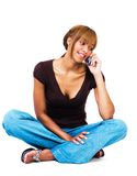 Mixed race woman talking on mobile phone Stock Photo