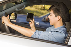 Mixed Race Woman Texting and Driving Stock Photography