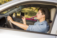 Mixed Race Woman Texting and Driving Royalty Free Stock Image