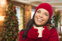 Mixed Race Woman Wearing Hat and Gloves In Christmas Setting Royalty Free Stock Image