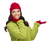 Mixed Race Woman Wearing Hat and Gloves Gesturing to Side Stock Photography