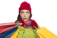 Mixed Race Woman Wearing Hat and Gloves Holding Shopping Bags Royalty Free Stock Photo