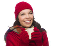 Mixed Race Woman Wearing Mittens Holds Mug Looks to Side Royalty Free Stock Photos