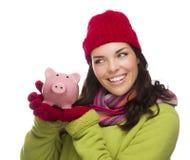Mixed Race Woman Wearing Winter Hat Holding Piggybank on White Royalty Free Stock Image