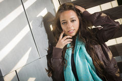 Mixed Race Young Adult Woman Against a Wood and Metal Wall Royalty Free Stock Image