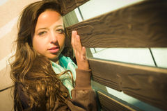 Mixed Race Young Adult Woman Against a Wood Wall Background Stock Photo