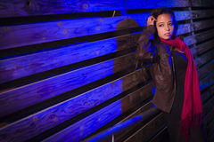 Mixed Race Young Adult Woman Against a Wood Wall Background Stock Photos