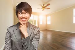 Mixed Race Young Adult Woman In Empty Room of House stock image
